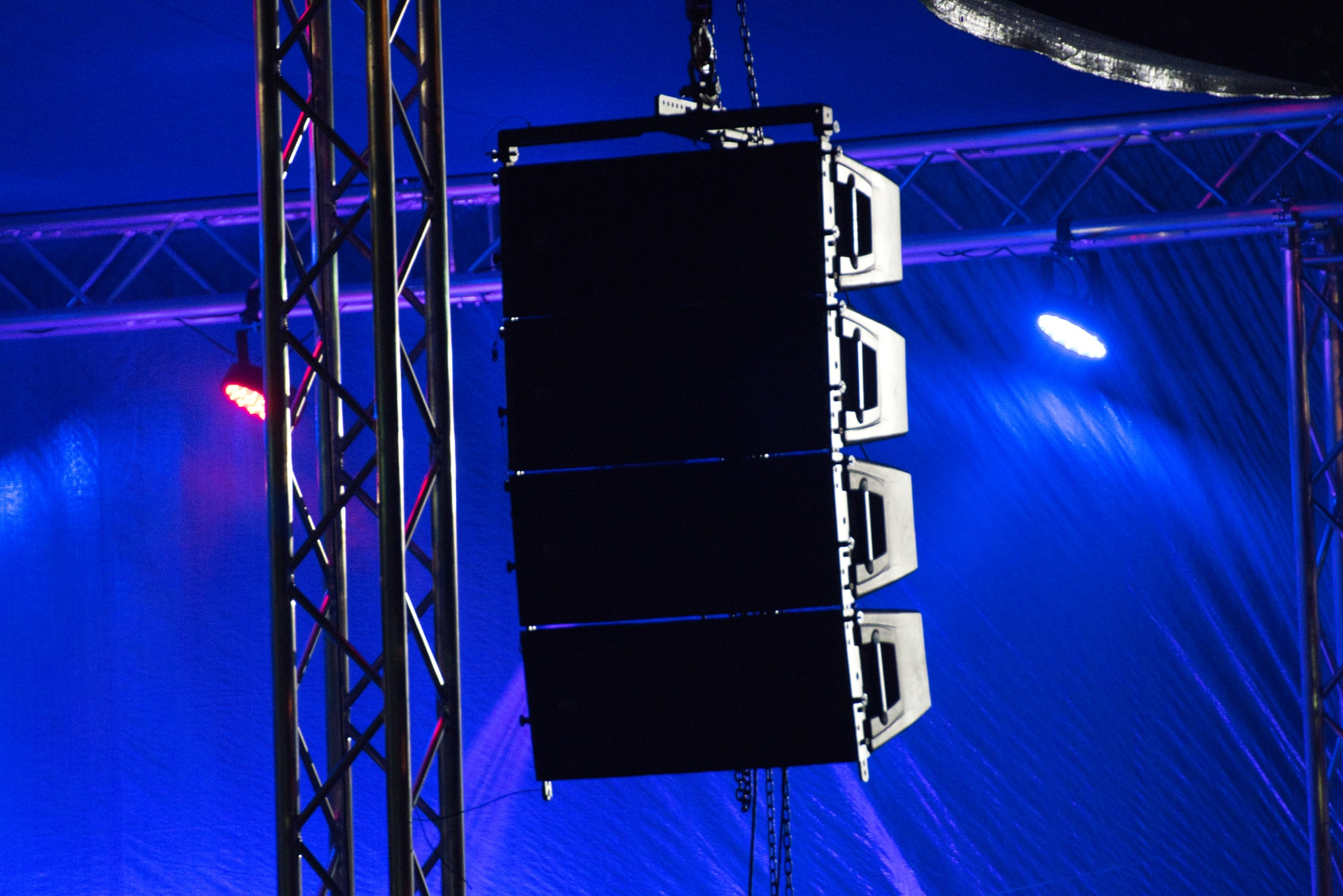Line Array hanging next to a stage